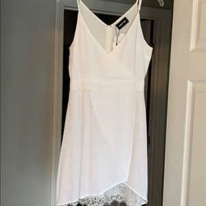 White shirt dress and lace underneath